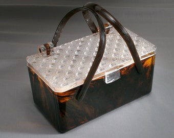 lucite bag complete with makeup