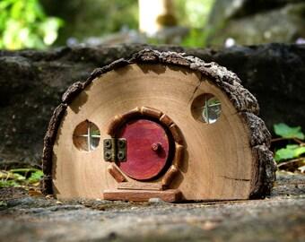 Rustic Wooden Hobbit house with Opening Red Door and Bark Roof