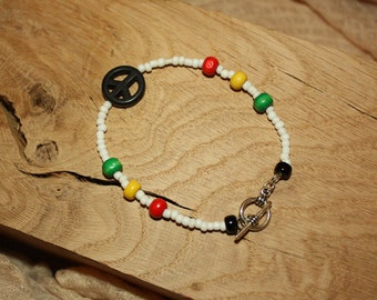 White Beaded Rasta Bracelet with coloured wood beads and howlite peace sign.