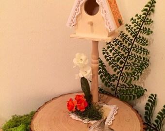 Bird house on pedestal