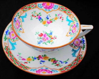 Minton china hand painted enamel art deco tea cup and saucer