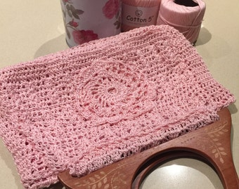 pink crocheet bag with wood handle
