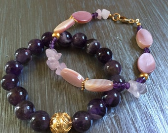 Amethyst and shell bracelet set.