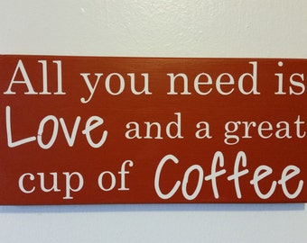 "Rustic ""All you need is love and a great cup of coffee"" sign"