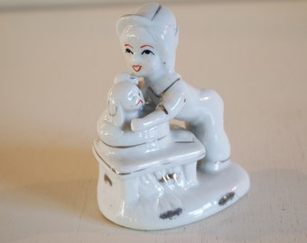 "small porcelain figurine "" a child and a dog"""