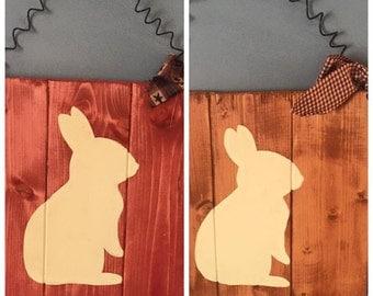 Rabbit silhoutee on wood panel