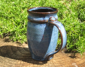 Stoneware mug approximately 14oz. Blue over black with black liner glaze.