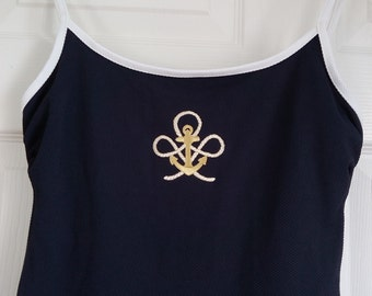 GABAR swimdress with the image of golden anchor on the front