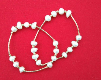 GORGEOUS PEARL BRACELETS WITH GOLD PLATED TUBE. Excellent for every day occasion, or gift souvenirs. Special price on orders 40 pcs or more.