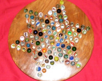 Vintage wooden Solitaire board with glass marbles