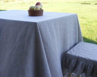 Natural Linen Tablecloth finished with mitered corners.