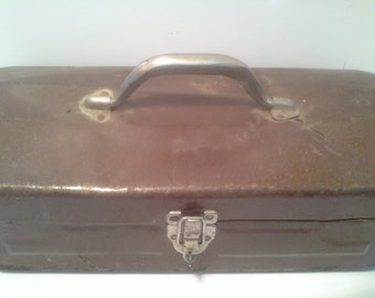 Dents are us....dented vintage metal tool box