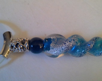 Let me see......blue art glass magnifying glass