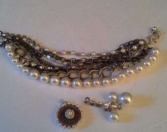 Multiple strand bracelet with rhinestones and pearls and 2 charms