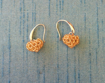 Handmade, heart shaped, gold color, earrings.