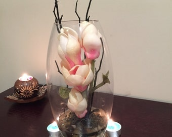 Pink magnolias with twigs in 25cm high cylindrical vase