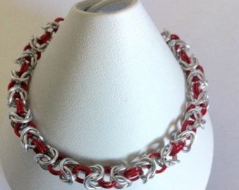 Chainmail bracelet. Byzantine weave bracelet mad with silver and red aluminium jump rings and a silver plated toggle clasp.