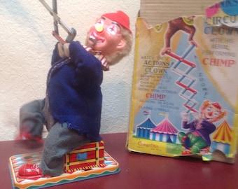 High Jinks Clown at Circus with aerial performing Chimp