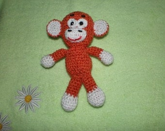 Soft knitted toy. Fire monkey, the symbol of 2016. Crocheted. The toy is handmade.
