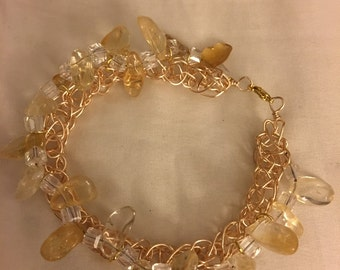 Citrine stone with gold wire