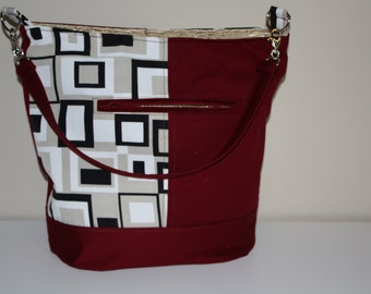 Red and tan Bucket bag
