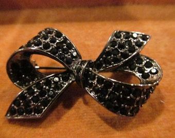 Vintage black rhinestone bow shaped brooch/pin; vintage brooch, vintage rhinestone brooch, black rhinestones