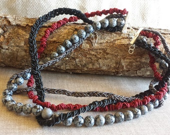 Necklace with grey stones and cords