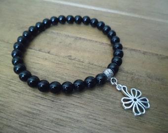 6mm Black Onyx Gemstones with a Tibetan Silver Charm