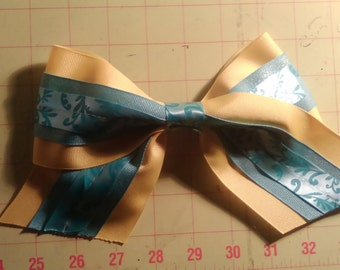 yellow and teal tri-level cheer bow