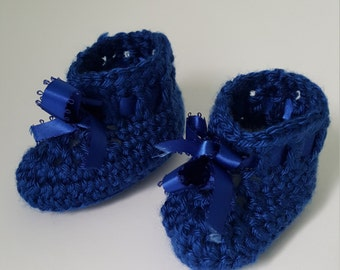 Blue newborn booties with ribbon tie