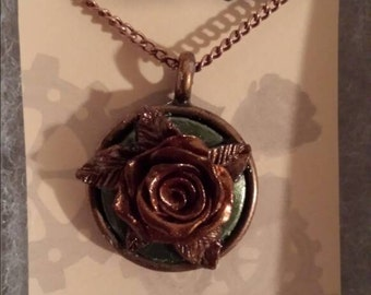 Copper circle pendant with rose