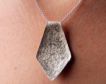 Tie pendant