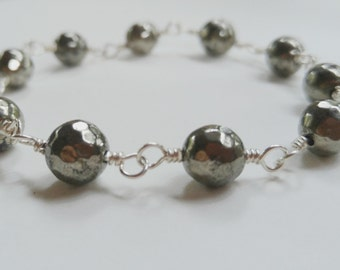 Faceted pyrite gemstone bracelet wire wrapped sterling silver