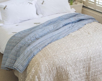 Grey floral and blue stripe quilt