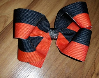 Black & orange basic Bowtique bow on alligator clip