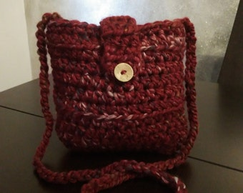 crochet shoulder purse in crimson with liner and coconut button