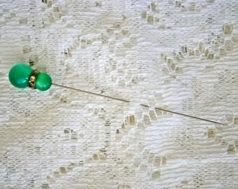 Beautiful green cabochon hat pin.