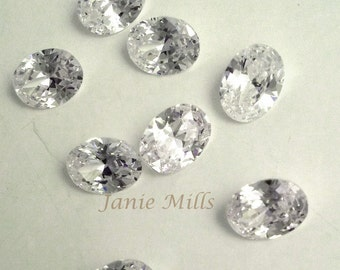 Clear Cubic Zirconia faceted 6x8 mm oval