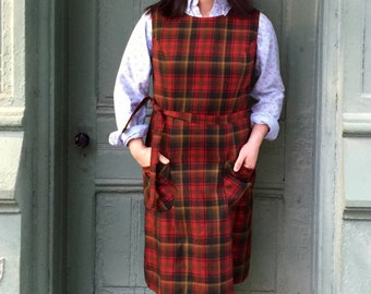 Plaid sleeveless dress. Brown with red, self tie . Fits 8