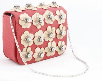 Handmade pink jute clutch with embellishments