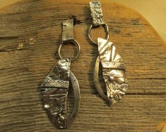 Wings sterling post earrings.