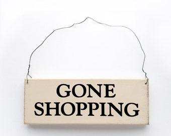 Wood sign saying: Gone Shopping