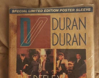 Duran duran  The Reflex 45 with poster sleeve
