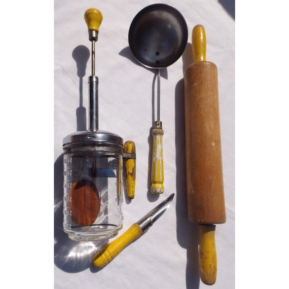 yellow wood handle kitchen utensils vintage glass food chopper wooden
