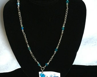 Glass beaded necklace with matching earrings