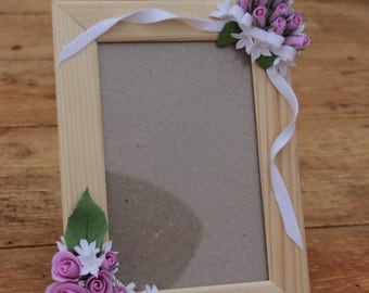 Frame with  pink roses