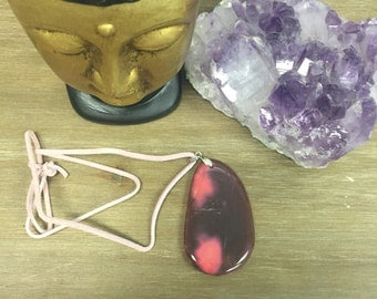 Maroon/pink colored stone pendant