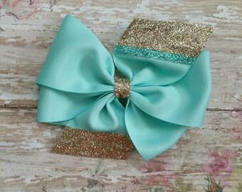 Teal and Gold Pinwheel Bow