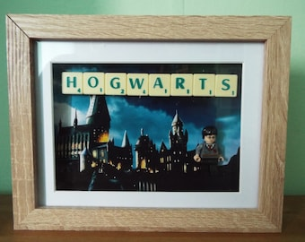 Harry Potter in school uniform custom lego mini figure with scrabble tiles in a frame