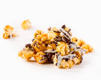 Chocolate drizzled caramel gourmet popcorn will satisfy all your chocolate cravings! Flavored popcorn - chocolate popcorn - popcorn bar